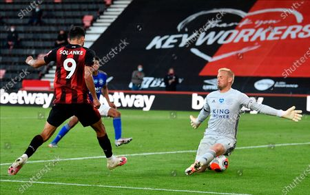 Bournemouth's Dominic Solanke (L) scores for a 4-1 lead past Leicester goalkeeper Kasper Schmeichel (R) during the English Premier League match between AFC Bournemouth and Leicester City in Bournemouth, Britain, 12 July 2020.