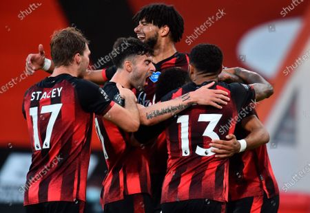 Bournemouth's Dominic Solanke (R) celebrates with teammmates after scoring for a 4-1 lead past Leicester during the English Premier League match between AFC Bournemouth and Leicester City in Bournemouth, Britain, 12 July 2020.