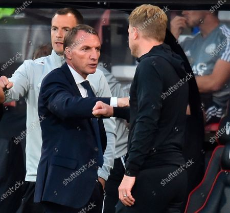 Manager of Leicester Brendan Rodgers (L) congratulates Bournemouth manager Eddie Howe (R) after the English Premier League match between AFC Bournemouth and Leicester City in Bournemouth, Britain, 12 July 2020.