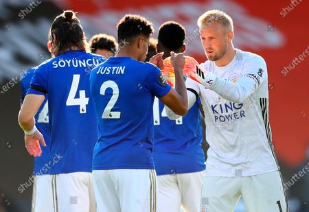 Leicester goalkeeper Kasper Schmeichel (R) and James Justin (L) fist bump before the English Premier League match between AFC Bournemouth and Leicester City in Bournemouth, Britain, 12 July 2020.