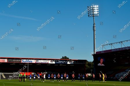 Players observe a minute of silence to remember former English international Jack Charlton before the English Premier League match between AFC Bournemouth and Leicester City in Bournemouth, Britain, 12 July 2020.