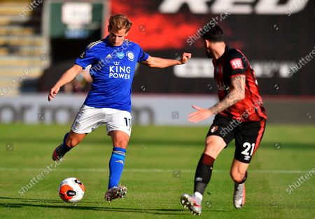 Leicester's Marc Albrighton (L) in action against Bournemouth's Diego Rico (R) during the English Premier League match between AFC Bournemouth and Leicester City in Bournemouth, Britain, 12 July 2020.