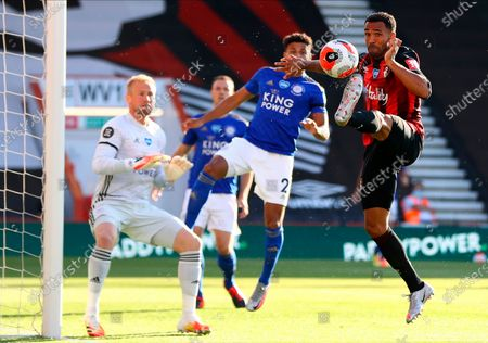 Bournemouth's Callum Wilson (R) in action against Leicester's James Justin (C) during the English Premier League match between AFC Bournemouth and Leicester City in Bournemouth, Britain, 12 July 2020.