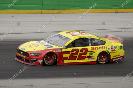 Joey Logano (22) drives during a NASCAR Cup Series auto race, in Sparta, Ky