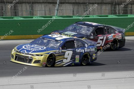 Chase Elliott (9) and Joey Gase (51) work during a NASCAR Cup Series auto race, in Sparta, Ky