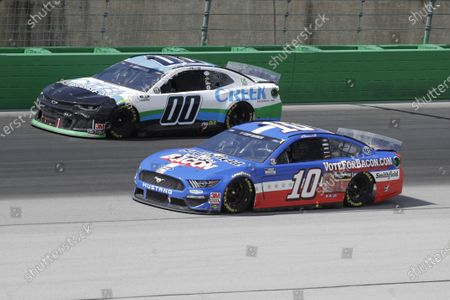 Quinn Houff (00) and Aric Almirola (10) work during a NASCAR Cup Series auto race, in Sparta, Ky