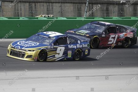 Chase Elliott (9) and Joey Gase (51) run during a NASCAR Cup Series auto race, in Sparta, Ky