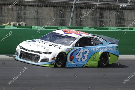Bubba Wallace (43) drives during a NASCAR Cup Series auto race, in Sparta, Ky