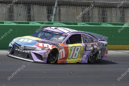 Kyle Busch (18) drives during a NASCAR Cup Series auto race, in Sparta, Ky