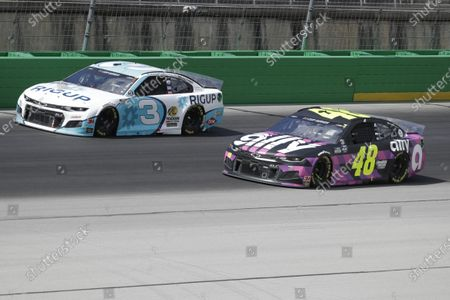 Austin Dillon (3) and Jimmie Johnson (48) run during a NASCAR Cup Series auto race, in Sparta, Ky