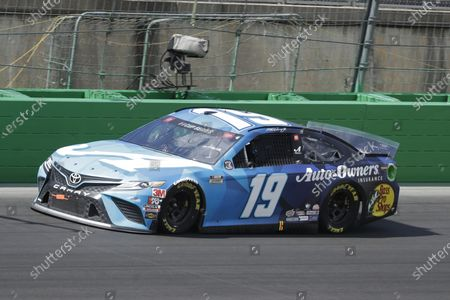 Martin Truex Jr. (19) drives during a NASCAR Cup Series auto race, in Sparta, Ky