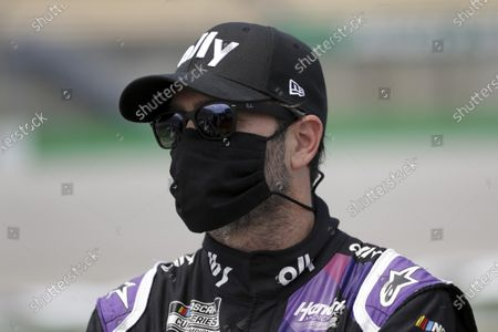 Jimmie Johnson waits for the start of a NASCAR Cup Series auto race, in Sparta, Ky