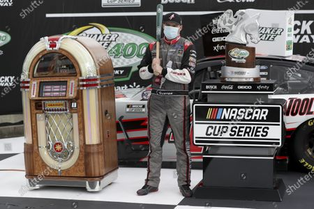 Cole Custer (41) celebrates with the trophy after winning a NASCAR Cup Series auto race, in Sparta, Ky