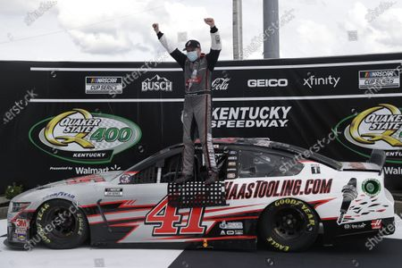 Cole Custer (41) celebrates after winning a NASCAR Cup Series auto race, in Sparta, Ky