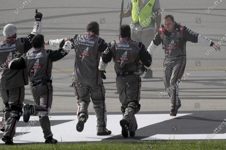 Cole Custer, right, celebrates with his crew after winning a NASCAR Cup Series auto race, in Sparta, Ky
