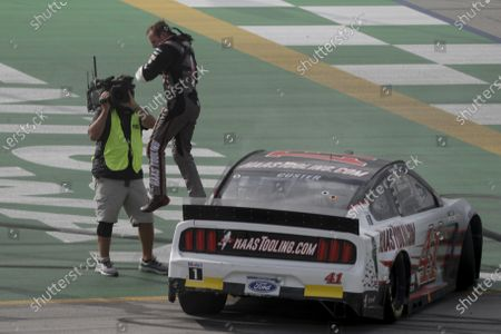 Cole Custer, top, celebrates after winning a NASCAR Cup Series auto race, in Sparta, Ky