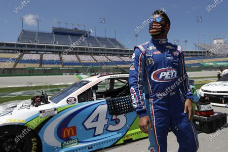 Bubba Wallace waits for the start of a NASCAR Cup Series auto race, in Sparta, Ky