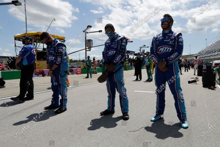 Bubba Wallace, right, waits for the start of a NASCAR Cup Series auto race, in Sparta, Ky