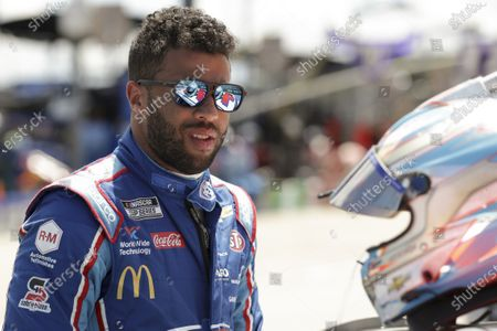 Bubba Wallace gets ready for the start of a NASCAR Cup Series auto race, in Sparta, Ky