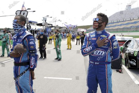 Bubba Wallace stands for the National Anthem before the start of a NASCAR Cup Series auto race, in Sparta, Ky