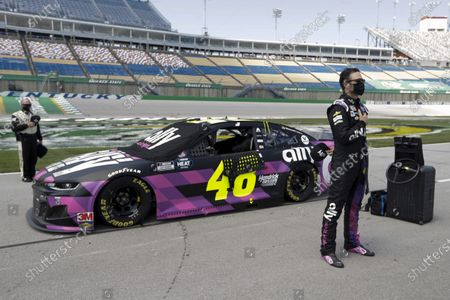 Jimmie Johnson stands for the National Anthem before for the start of a NASCAR Cup Series auto race, in Sparta, Ky
