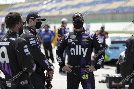 Jimmie Johnson, right, waits for the start of a NASCAR Cup Series auto race, in Sparta, Ky
