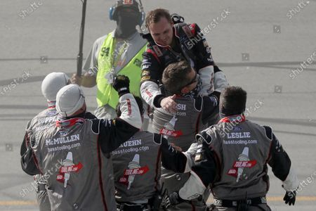 Cole Custer, top, celebrates with his crew after winning a NASCAR Cup Series auto race, in Sparta, Ky
