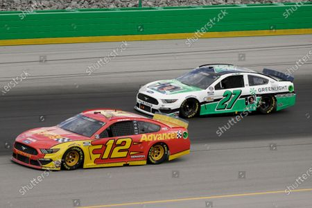 Ryan Blaney, left, and JJ Yeley (27) run during a NASCAR Cup Series auto race, in Sparta, Ky
