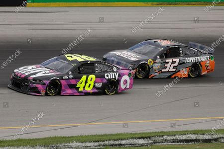 Jimmie Johnson, left, and Corey LaJoie run drives during a NASCAR Cup Series auto race, in Sparta, Ky