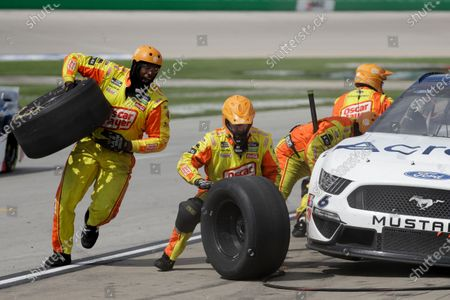 Ryan Newman (6) makes a pit stop during a NASCAR Cup Series auto race, in Sparta, Ky
