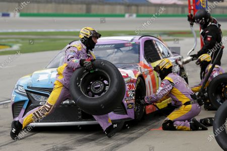 Kyle Busch (18) makes a pit stop during a NASCAR Cup Series auto race, in Sparta, Ky