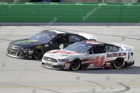 Kurt Busch (1) and Cole Custer (41) work during a NASCAR Cup Series auto race, in Sparta, Ky