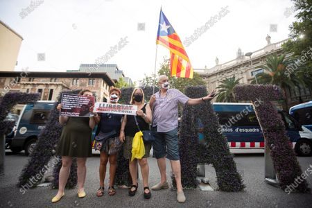 Members of Catalan pro-independence groups Asamblea Nacional Catalana (ANC) and Omnium Cultural attend a protest to demand the release of former president of Catalan pro-independence group ANC, Jordi Sanchez, and Omnium Cultural president, Jordi Cuixart, who turn 1,000 days in prison, in front of Governement's delegation in Barcelona, Catalonia, Spain, 12 July 2020.