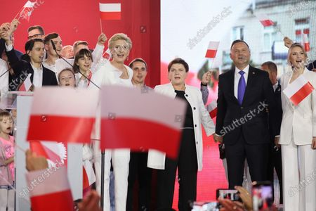Incumbent President Andrzej Duda (2-R) with his wife Agata Kornhauser-Duda (C-L) and daughter Kinga Duda (R) with former Polish Prime Minister Beata Szydlo (C) react after initial exit polls in Polish Presidential elections in Pultusk, Poland, 12 July 2020. According to initiall exit polls, Polish President Andrzej Duda has won percent 50.4 percent of votes and Civic Coalition candidate and Mayor of Warsaw Rafal Trzaskowski has won 49.6 percent of votes in the second round of presidential elections in Poland.