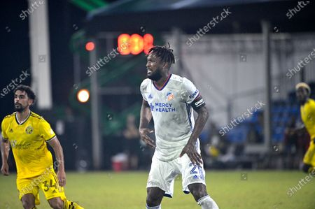 Stock Picture of Cincinnati defender Kendall Waston (2) and Columbus Crew midfielder Youness Mokhtar (34) follow a play during an MLS soccer match, in Kissimmee, Fla