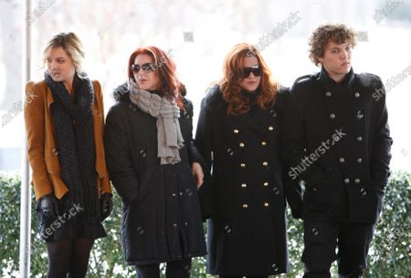 "Priscilla Presley, second from left, her daughter, Lisa Marie Presley, second from right, and Lisa Marie's children, Riley Keough, left, and Benjamin Keough, right, take part in a ceremony in Memphis, Tenn., commemorating Elvis Presley's 75th birthday. Keough has died. Lisa Marie Presley's representative Roger Widynowski said in a statement, to The Associated Press that she was ""heartbroken"" after learning about the death of her Keough"