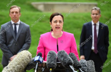 Queensland Premier Annastacia Palaszczuk, flanked by Deputy Premier and Health Minister Steven Miles (L) and University of Queensland as Vice-Chancellor Peter Hoj (R), speaks during a press conference in Brisbane, Australia, 13 July 2020. According to local media reports, Ms Palaszczuk said it was an exciting day for Queensland as human trials have begun for a potential COVID-19 vaccine developed by the University of Queensland (UQ).