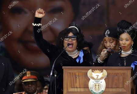 """Zindzi Mandela, the daughter of the late Nelson Mandela poses for photographers as she arrives to attend the UK premiere of the movie """"Mandela: Long Walk to Freedom"""" at a cinema in London. Zindzi Mandela, age 59, has died early Monday at a Johannesburg hospital according to state media"""