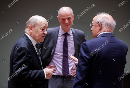 (L-R) French Foreign Minister Jean-Yves Le Drian, Dutch Foreign Minister Stef Blok and Portuguese Foreign Minister Augusto Santos Silva attend a European Union (EU) foreign ministers meeting at the European Council building in Brussels, Belgium, 13 July 2020. EU foreign ministers meet for the first time face-to-face since Europe eased coronavirus lockdown restrictions, and they are expected to discuss their relations with China and Turkey.