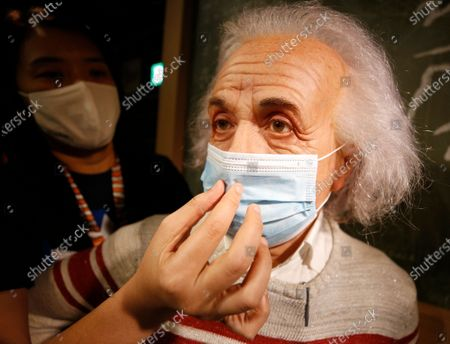 A staff member puts a mask on a wax statue of theoretical physicist Albert Einstein at the Madame Tussauds Museum in Bangkok, Thailand, 13 July 2020. According to local media reports, Thailand is expected to produce a vaccine for COVID19 by the third quarter of 2021. The first phase of human trials will begin in October 2020 with over 10,000 participants between Thai nationals and foreigners, Thai Professor of Chula Vaccine Research Center, Kiat Ruxrungtham said.