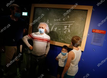 Visitors pose next to a wax statue of theoretical physicist Albert Einstein at the Madame Tussauds Museum in Bangkok, Thailand, 13 July 2020. According to local media reports, Thailand is expected to produce a vaccine for COVID19 by the third quarter of 2021. The first phase of human trials will begin in October 2020 with over 10,000 participants between Thai nationals and foreigners, Thai Professor of Chula Vaccine Research Center, Kiat Ruxrungtham said.