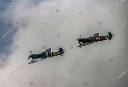 Picture dated July 10th shows two Spitfires after taking off from RAF Coningsby, Lincolnshire, on Friday morning to do a flypast for Vera Lynn's funeral today.