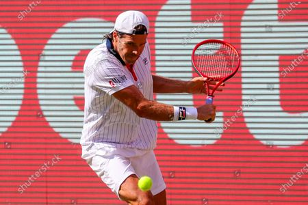 Tommy Haas of Germany in action against Jannik Sinner of Italy during their match at the bett1ACES tennis tournament at the Steffi-Graf-Stadium in Berlin, Germany, 13 July, 2020. The tournament is the first sports event hosting spectators in Germany and will be held under strict hygiene restrictions made to cope with the spread of the coronavirus SARS-CoV-2 which causes the COVID-19 disease.