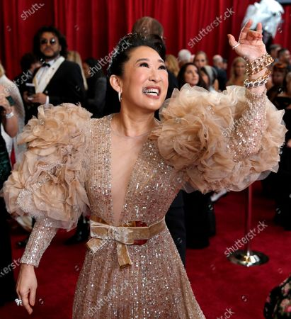 Sandra Oh arrives at the Oscars in Los Angeles. Oh turns 49 on July 20