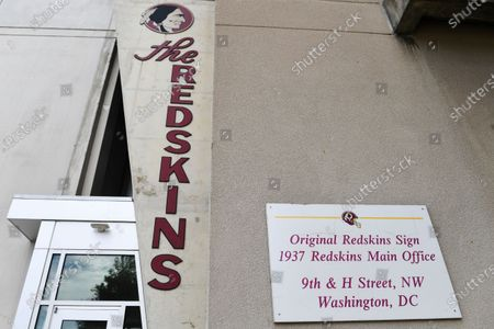 "Signs for the Washington Redskins are displayed outside FedEx Field in Landover, Md., . The Washington NFL franchise announced Monday that it will drop the ""Redskins"" name and Indian head logo immediately, bowing to decades of criticism that they are offensive to Native Americans"