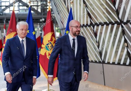 Montenegrin Prime Minister Dusko Markovic (L) is welcomed by European Council President Charles Michel ahead of a meeting at the European Council building in Brussels, Belgium, 13 July 2020.