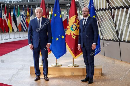 Stock Picture of Montenegrin Prime Minister Dusko Markovic (L) is welcomed by European Council President Charles Michel ahead of a meeting at the European Council building in Brussels, Belgium, 13 July 2020.