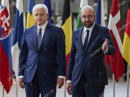Stock Photo of Montenegro's Prime Minister Dusko Markovic, left, is lead by European Council President Charles Michel before their meeting at the Europa building in Brussels