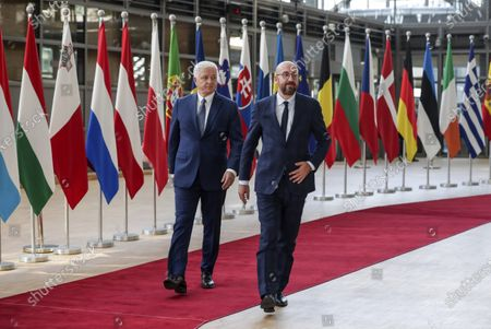 Montenegro's Prime Minister Dusko Markovic, left, is welcomed by European Council President Charles Michel before their meeting at the Europa building in Brussels