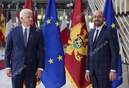 Montenegro's Prime Minister Dusko Markovic, left, and European Council President Charles Michel pose for the media before their meeting at the Europa building in Brussels